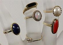 A LOT OF 6 LADIES RINGS with gems. 333/000 gold