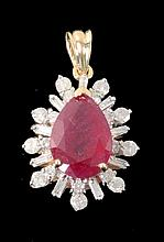 A RUBY AND DIAMOND SET PENDANT 750/000 yellow