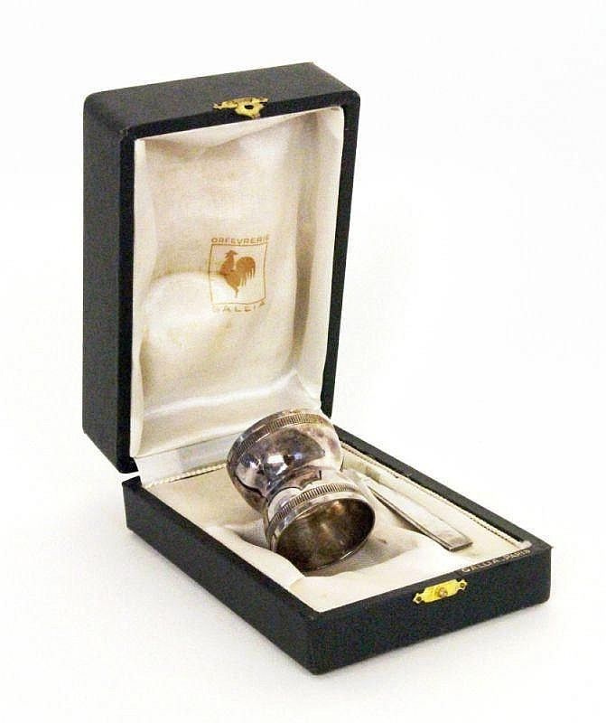 A CHRISTOFLE EGG CUP WITH SPOON in original box