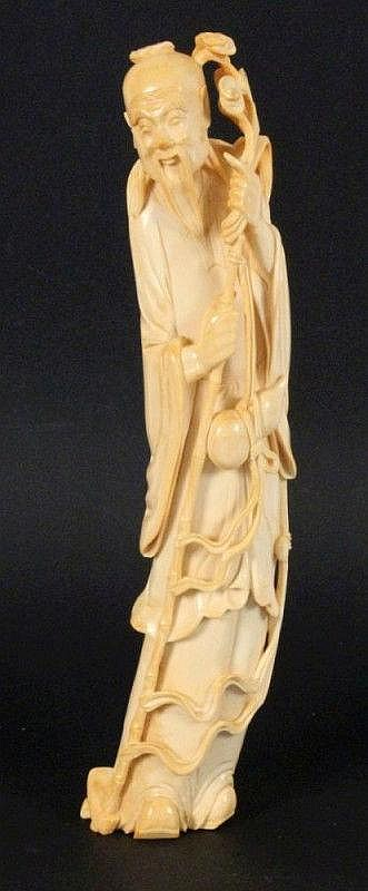 A CHINESE PILGRIM China ca. 1900 Carved ivory