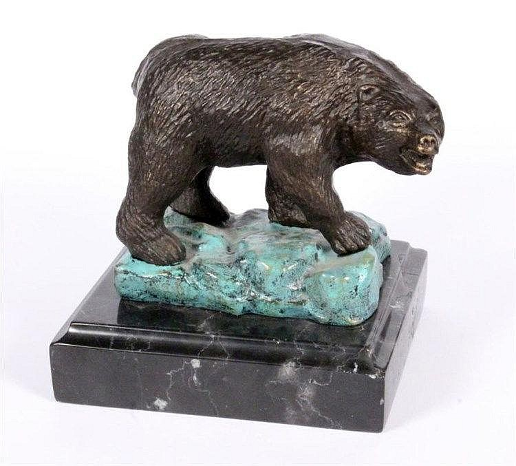 A RUSSIAN BEAR Patinated bronze. Marble base