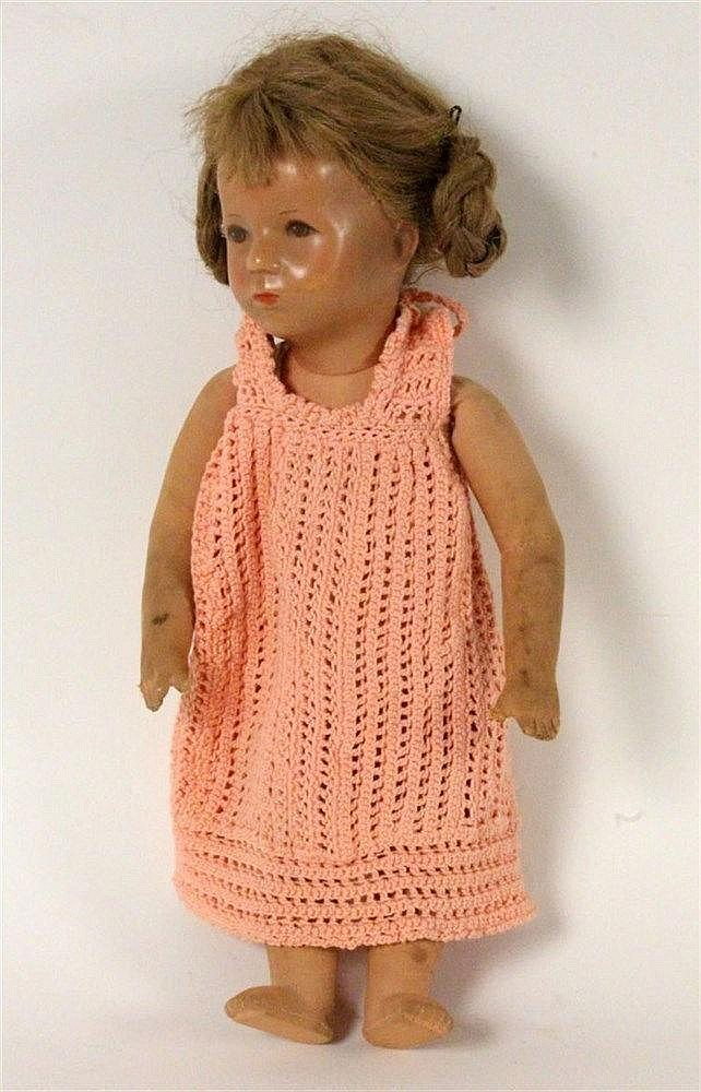 A KAETHE KRUSE DOLL Painted plastic head with