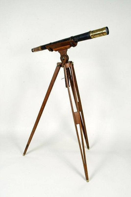 AN OLD TELESCOPE WITH TRIPOD