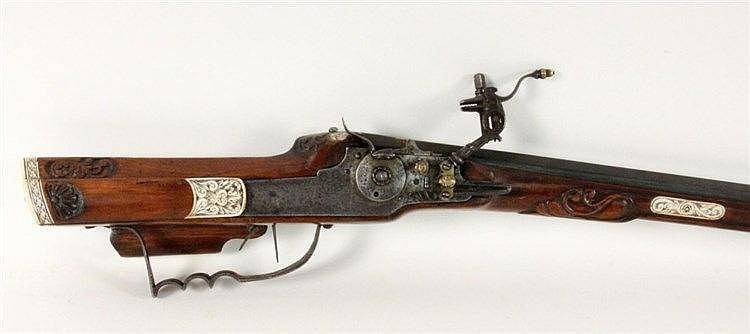 A WHEELLOCK RIFLE ca. 1630, Walnut full stock