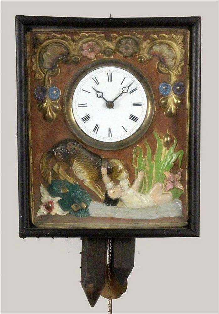 A WALL CLOCK Black Forest, 19th century Blackened