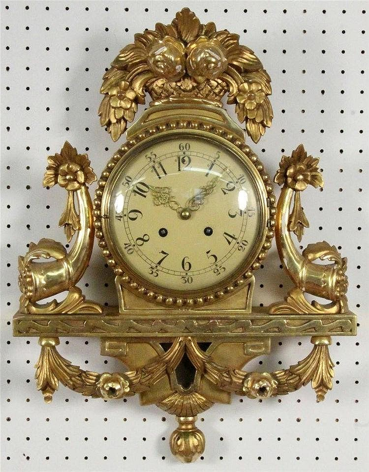 A BAROQUE STYLE WALL CLOCK Sweden. Gilt wood with