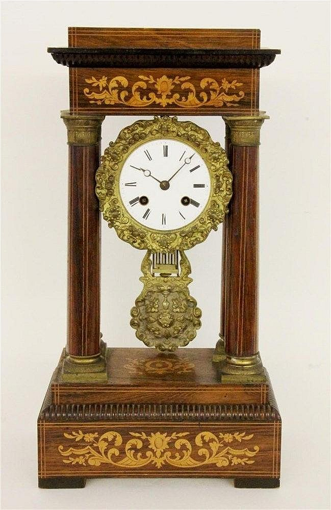 A COLUMN CLOCK France, 19th century Rosewood with