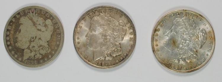 ( 3 ) MORGAN SILVER DOLLARS: 1894-O VG, 1887 BU & 1889 BU