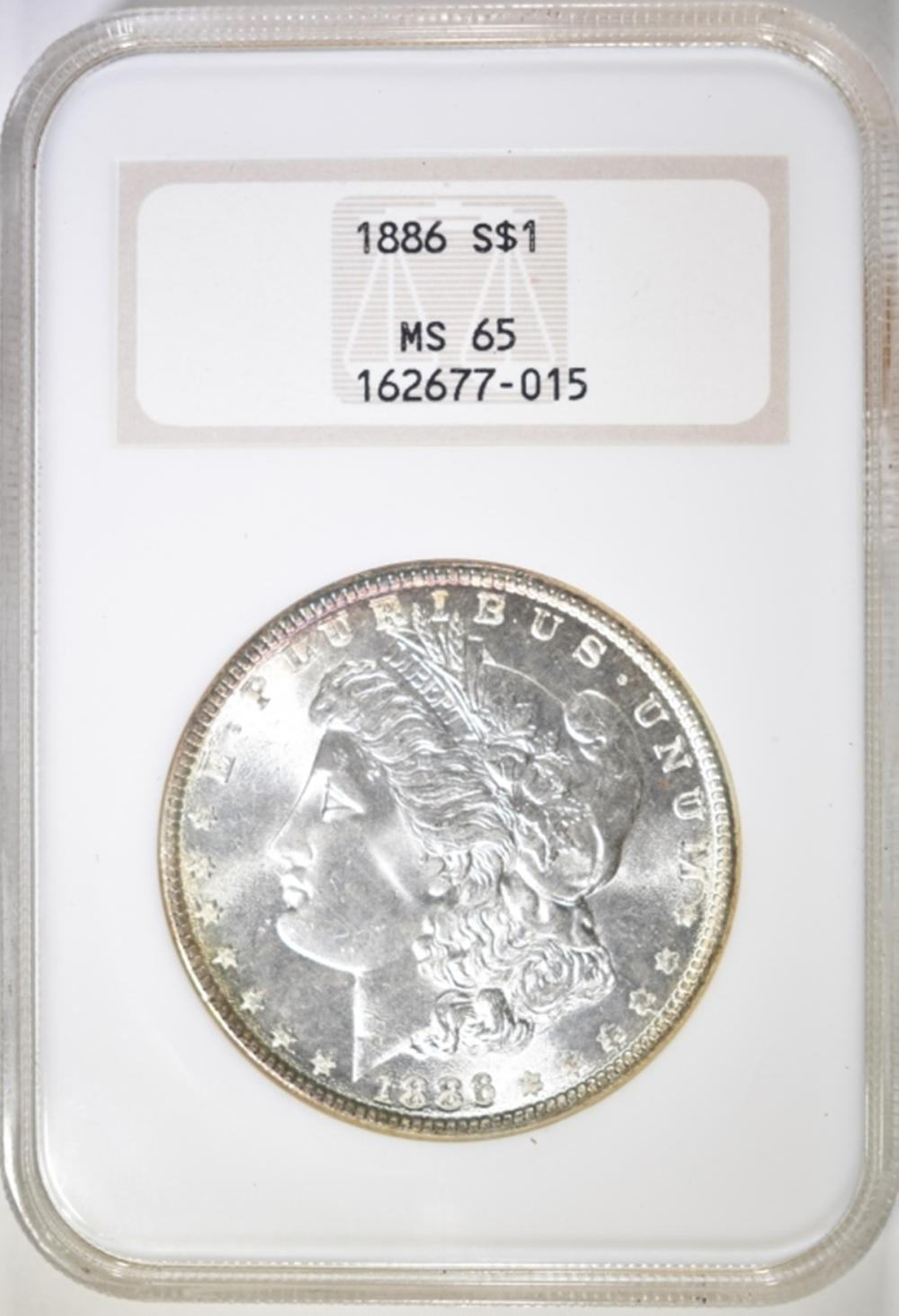 Lot 62: 1886 MORGAN DOLLAR NGC MS-65