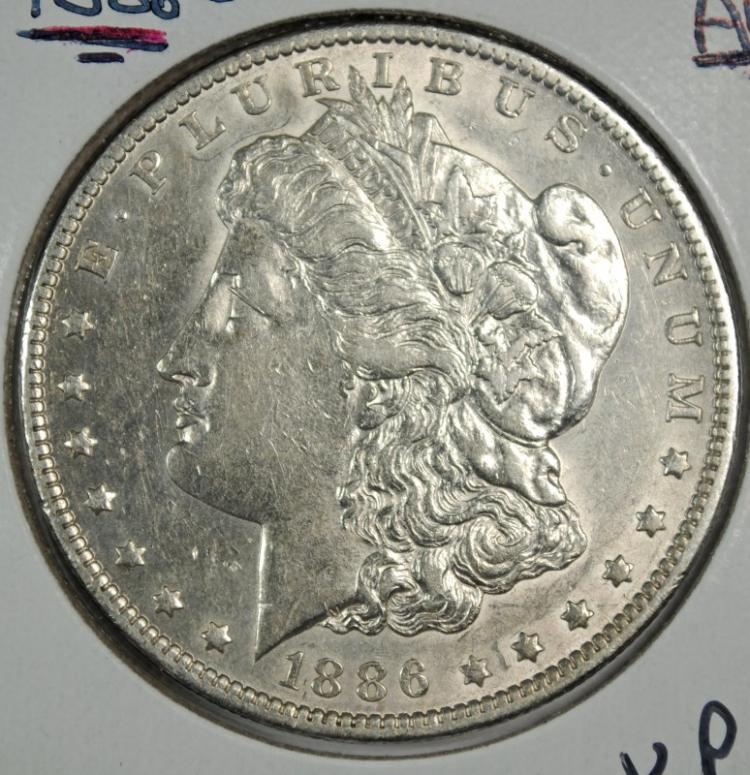 1886-O MORGAN SILVER DOLLAR, CHOICE AU