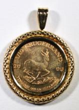 1/10 OUNCE GOLD SOUTH AFRICAN KRUGERRAND IN FANCY 14K GOLD BEZEL