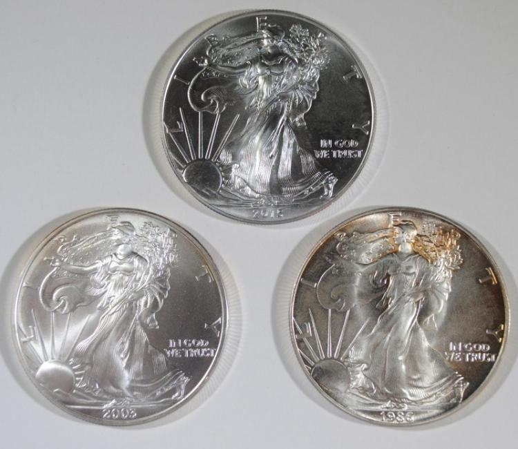 3 - GEM BU SILVER AMERICAN SILVER EAGLES - 1986, 2003, 2015
