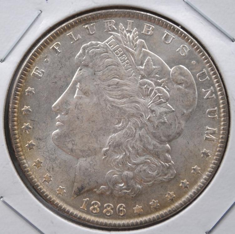 1886 MORGAN DOLLAR CH BU TONED REV.