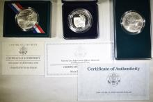 Lot 84: LOT OF 3 SILVER DOLLARS, ALL WITH COA: