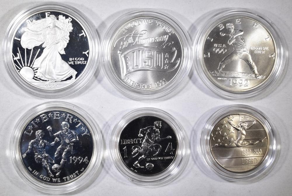 Lot 85: LOT OF 4 SILVER COIN SETS WITH COA: