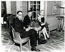 MARILYN MONROE,ARTHUR MILLER, AND PETER LAWFORD AT A PARTY PHOTOGRAPH.