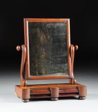 AN EARLY VICTORIAN CARVED MAHOGANY GENTLEMAN'S SHAVING MIRROR STAND, CIRCA 1850,