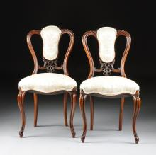 A PAIR OF VICTORIAN CARVED MAHOGANY AND UPHOLSTERED SIDE CHAIRS, THIRD QUARTER 19TH CENTURY,