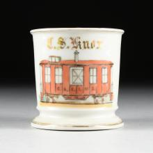 A CHARLES FIELD HAVILAND PORCELAIN OCCUPATIONAL SHAVING MUG -- CHICAGO AND EASTERN ILLINOIS RAILROAD CABOOSE, LIMOGES, FRANCE, CIRCA 1890-1900,