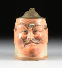 AN AUGUSTE HANKE (German 1875-1938) PEWTER MOUNTED GLAZED STONEWARE CHARACTER STEIN, HOHR-GRENZHAUSEN, GERMANY, CIRCA 1900,