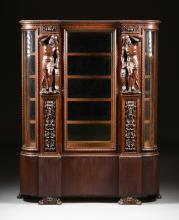 AN AMERICAN BAROQUE STYLE MIRROR BACKED FIGURAL CARVED OAK VITRINE, PROBABLY GRAND RAPIDS, MICHIGAN, CIRCA 1885-1895,