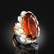 A 14K TWO TONE GOLD, OPAL, AND DIAMOND LADY'S RING,