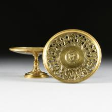 A PAIR OF CAST BRASS MEDALLION PLATE STANDS, PROBABLY AMERICAN, CIRCA 1900,