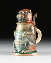 A GERMAN GLAZED CERAMIC AND PEWTER MOUNTED FIGURAL CHARACTER BEER STEIN, CIRCA 1900,