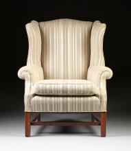 AN AMERICAN UPHOLSTERED MAHOGANY WING BACK ARMCHAIR, 20TH CENTURY,