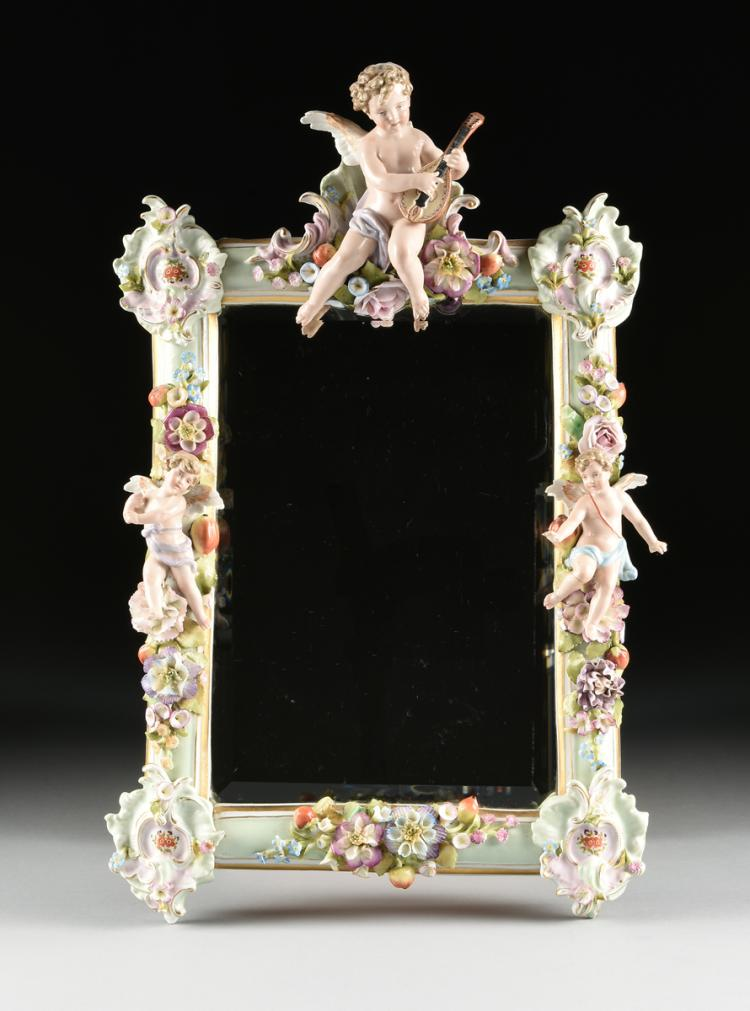 A GERMAN PAINTED AND FLORAL ENCRUSTED PORCELAIN MIRROR, C.G. SCHIERHOLZ, UNDERGLAZE BLUE MARK, CIRCA 1880 - 1906,