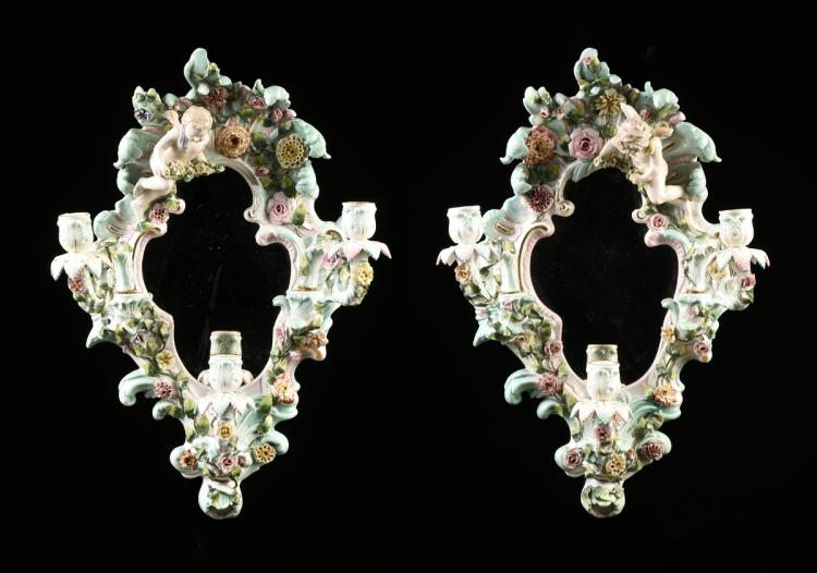 A PAIR OF GERMAN FLORAL ENCRUSTED THREE LIGHT GIRANDOLE MIRRORS, VOIGT BROTHERS, SITZENDORFER MANUFACTORY BLUE MARK, CIRCA 1880'S,