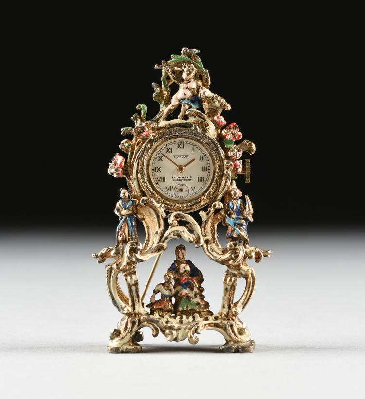 A CONTINENTAL MINIATURE ENAMELED SILVER GILT BROOCH CLOCK, POSSIBLY AUSTRIAN, SWISS 17 JEWELS, SHOCK RESISTANT MOVEMENT, RETAILED BY TAYLOR, 20TH CENTURY,