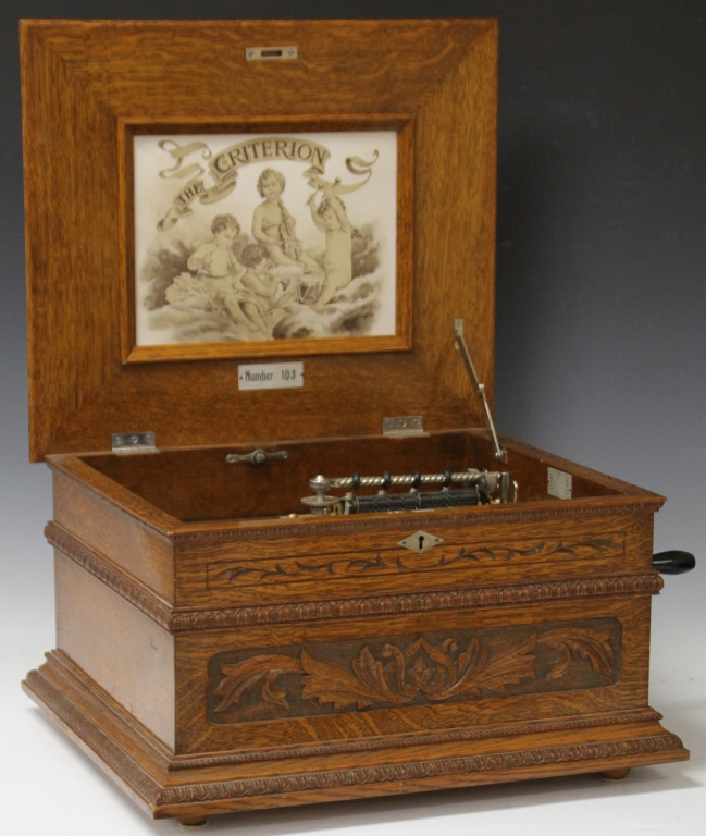 CRITERION CARVED OAK MUSIC BOX WITH 14