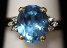 LADY'S 14KT BLUE TOPAZ RING