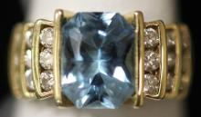 LADY'S BLUE TOPAZ AND DIAMOND 14KT RING