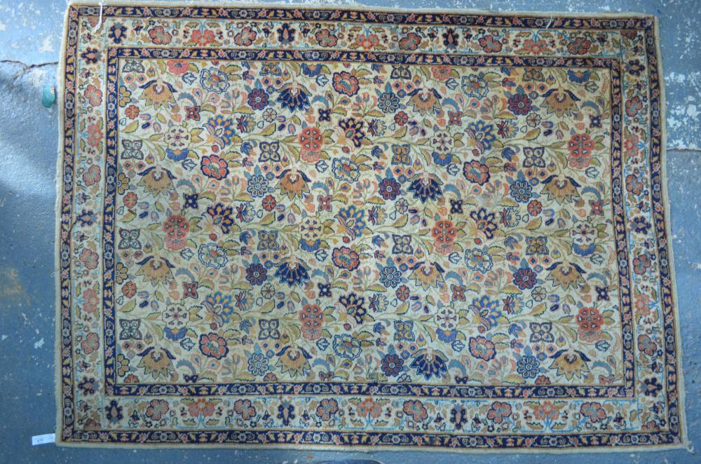 An old Persian Kashan carpet, the floral design on camel ground