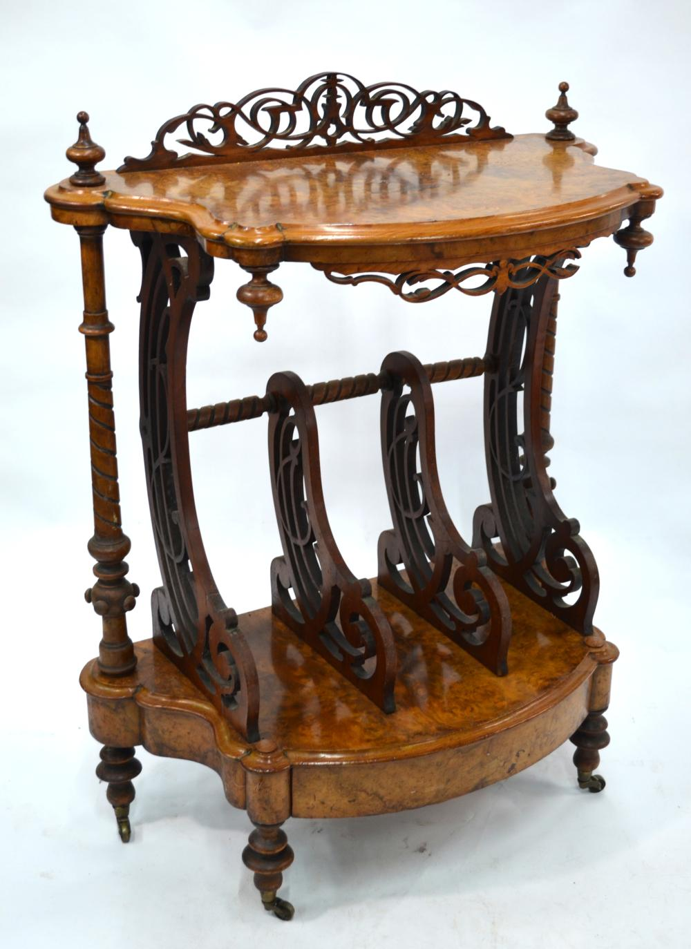 A Victorian burr walnut two tier what-not of serpentine form
