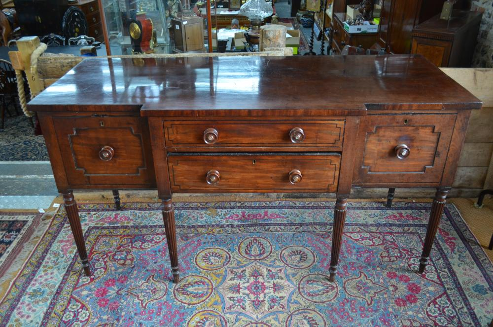 A George III mahogany breakfront serving sideboard