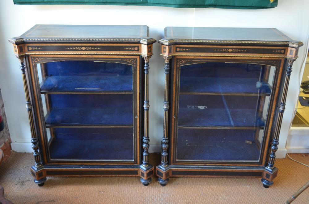 A pair of Victorian ebonised, amboyna and ormolu mounted pier cabinets