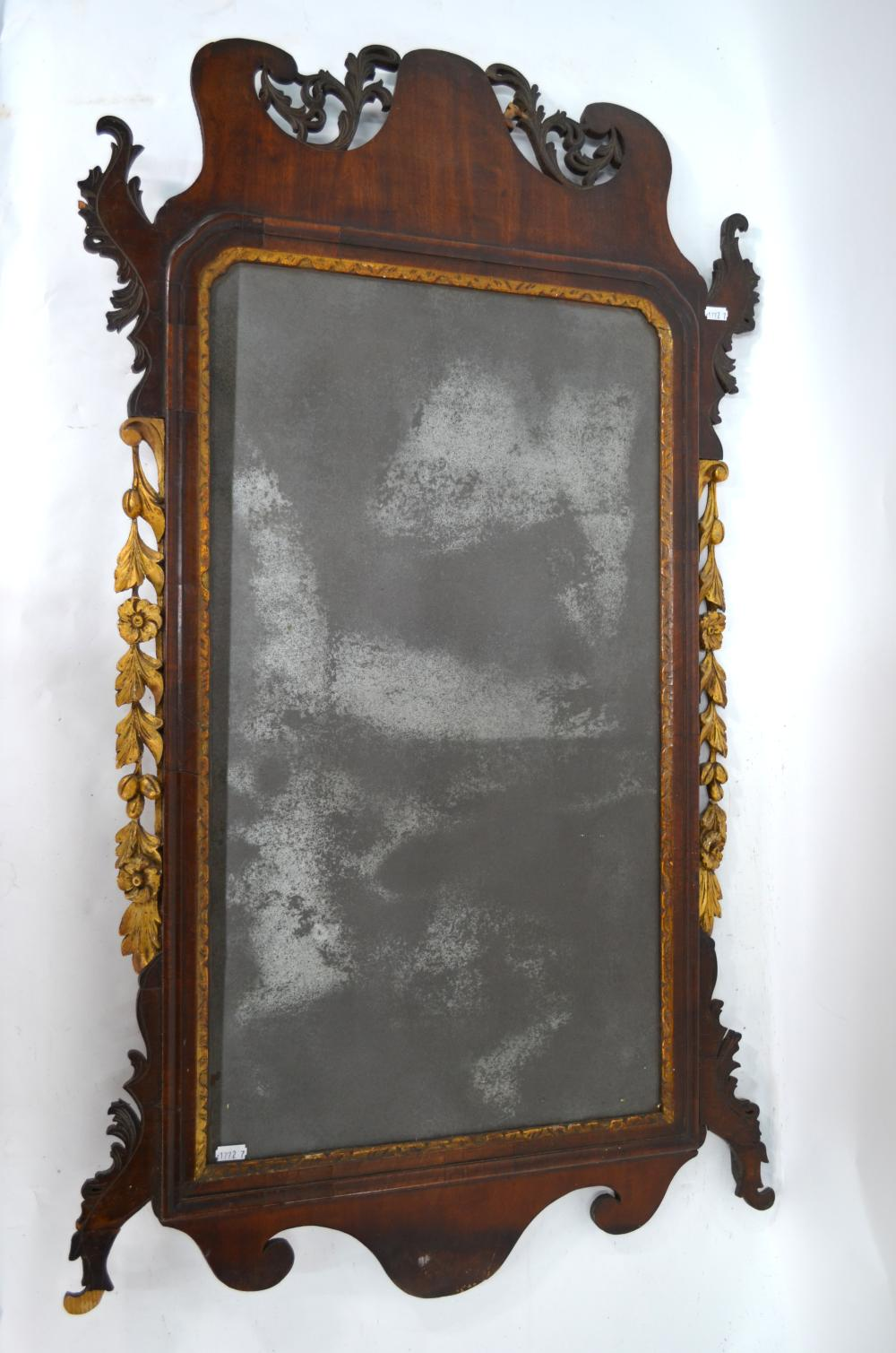 An 18th century mahogany fret cut and parcel gilt adorned pier glass