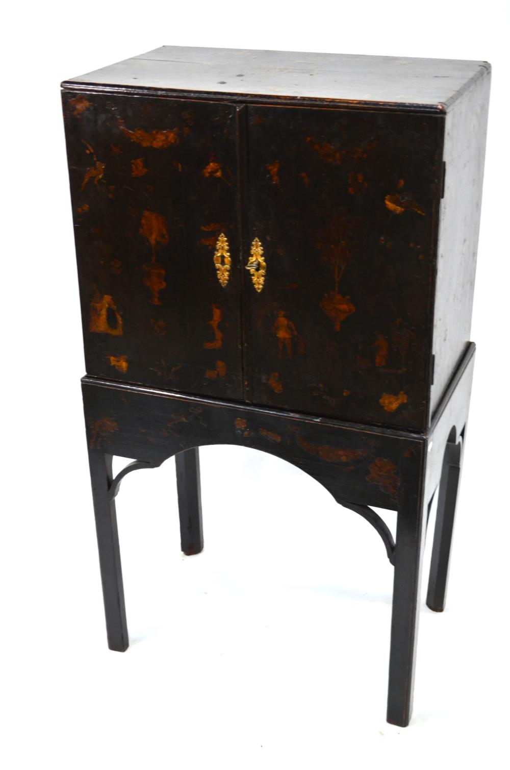 An 18th century black lacquered and decorated cabinet on stand