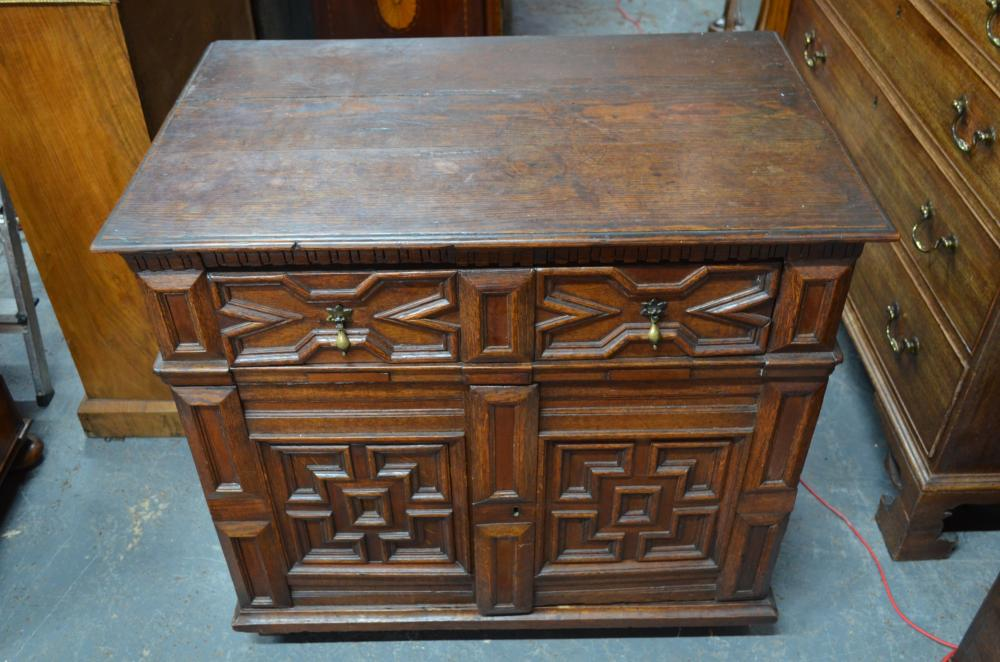 An antique Jacobean style oak chest, in two parts