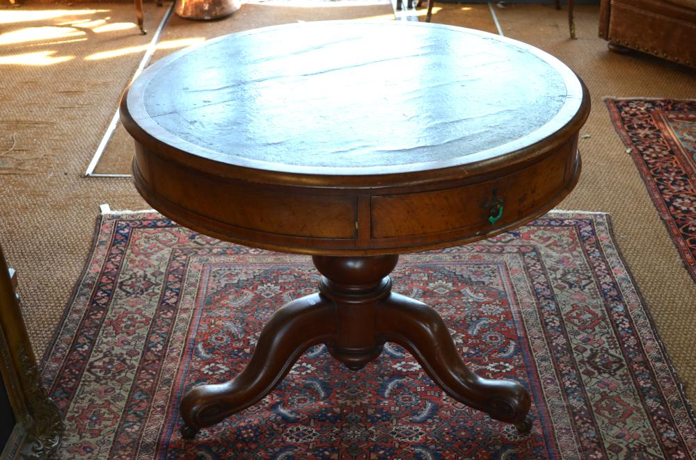 A small Victorian mahogany drum library table