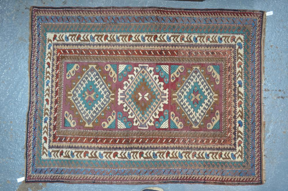 An old Caucasian geometric design rug