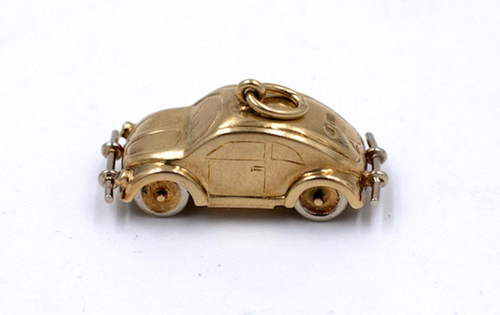 Lot 8752: Rare VW Charm, 14 karat Yellow-Rose Gold, Movable Parts, 1 inch