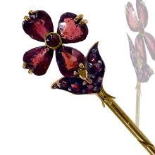 Lot 9036: Gregorian, Flower Stick Pin, Antique-Cut Garnets