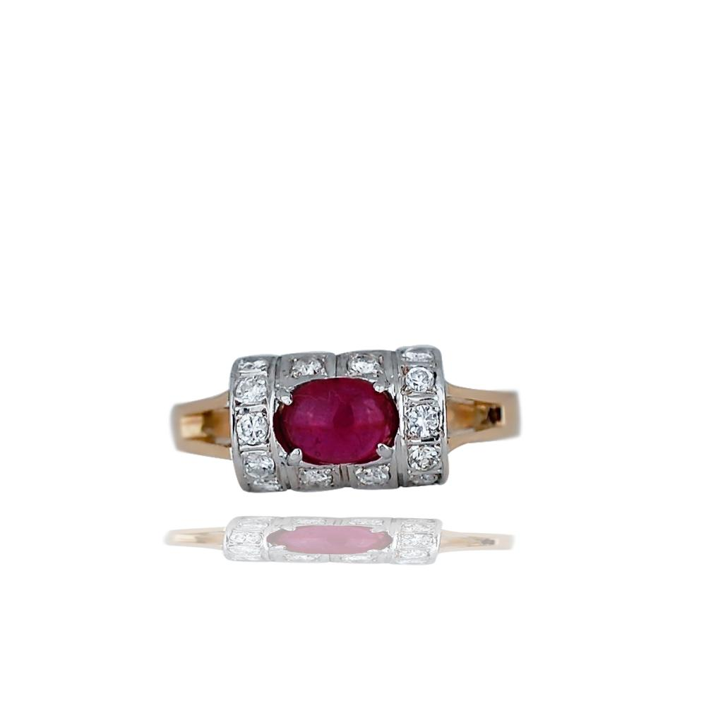 14 Kt Ring, Modern style concex, pave setting with an oval ruby cabochon gemstone.