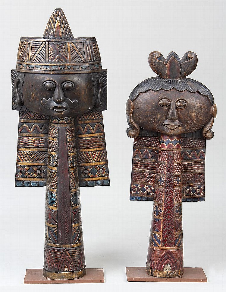 Pair of carved wood statues as king and queen