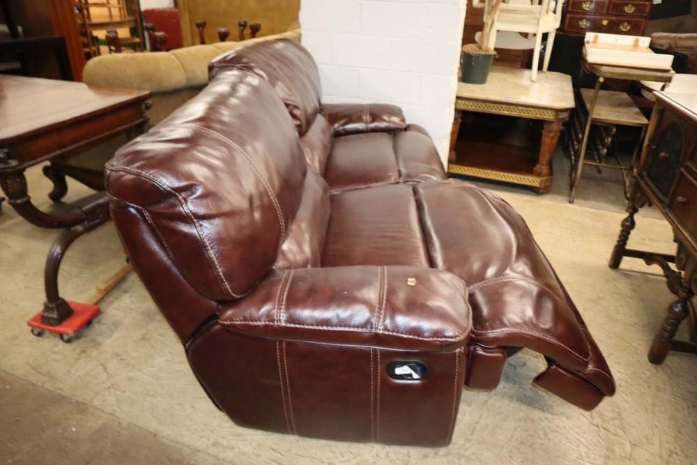 Burgundy double stitched leather reclining sofa