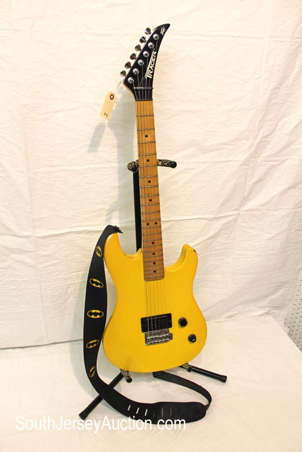 1980's Peavey Tracer in the yellow, with batman strap, made in the US, fair condition with some chips and missing back plate s/n 03379067